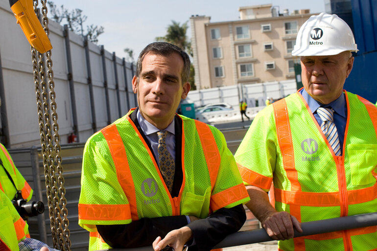 Los Angeles Mayor Eric Garcetti, left, touring the construction site of a new subway stop.