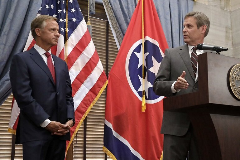 Tennessee Gov.-elect Bill Lee, right, speaks during a news conference with outgoing Gov. Bill Haslam.