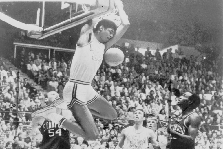 Kareem Abdul-Jabbar dunking the basketball