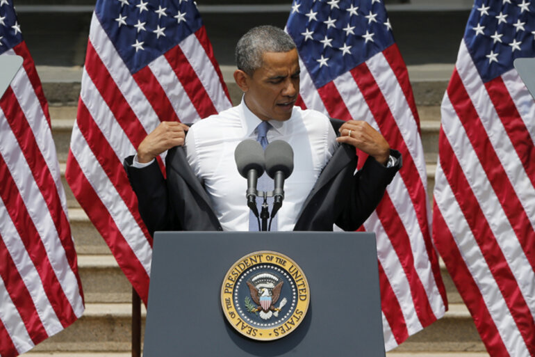President Barack Obama removes his jacket before speaking at Georgetown University in Washington, D.C.