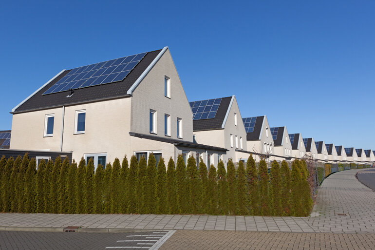 Row of houses with solar panels.