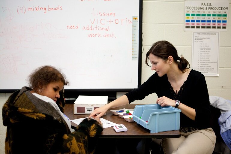 Teacher working with a student with disabilities.