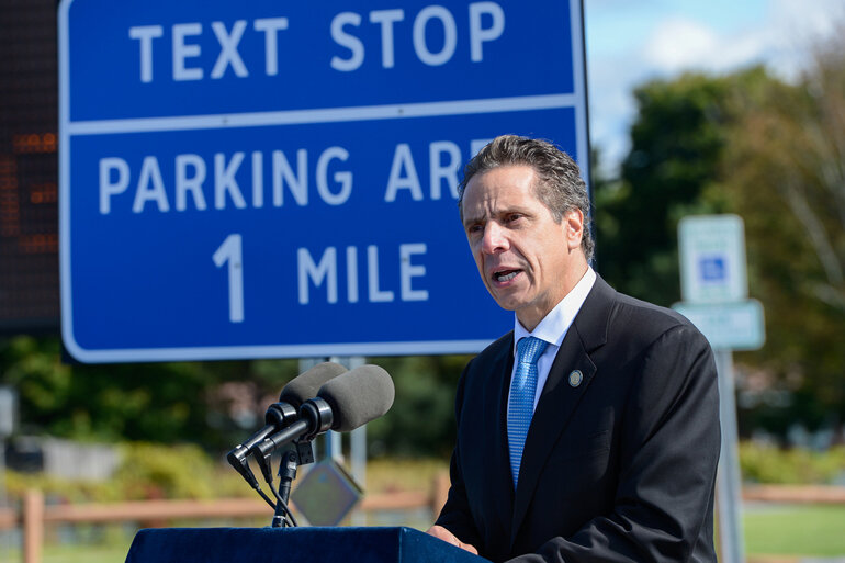 New York is using highway signs to highlight park-and-ride facilities, rest stops and other areas along the state's roads as places where drivers can safely use their cellphones.