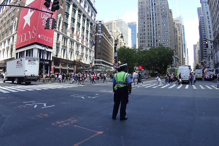 Traffic cop in New York City intersection.
