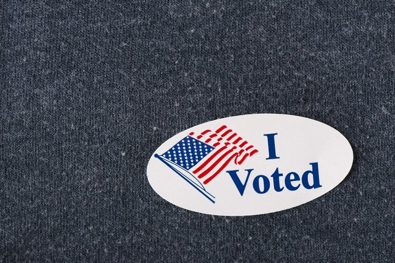 I Voted sticker on a shirt.