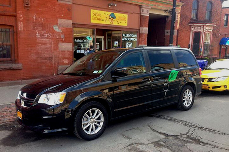 A minivan parked in front of Buffalo CarShare that's part of its fleet.
