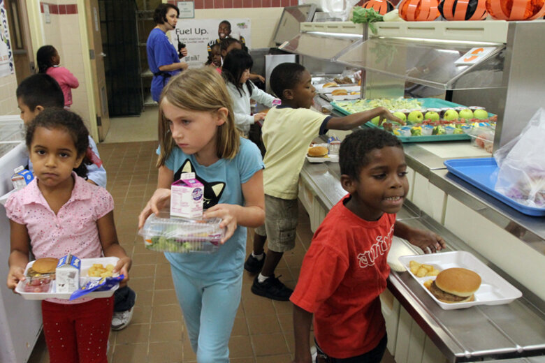 Elementary school students get lunch at a school in Osceola County, Fla., where 71 percent of students are eligible for free or reduced price meals.