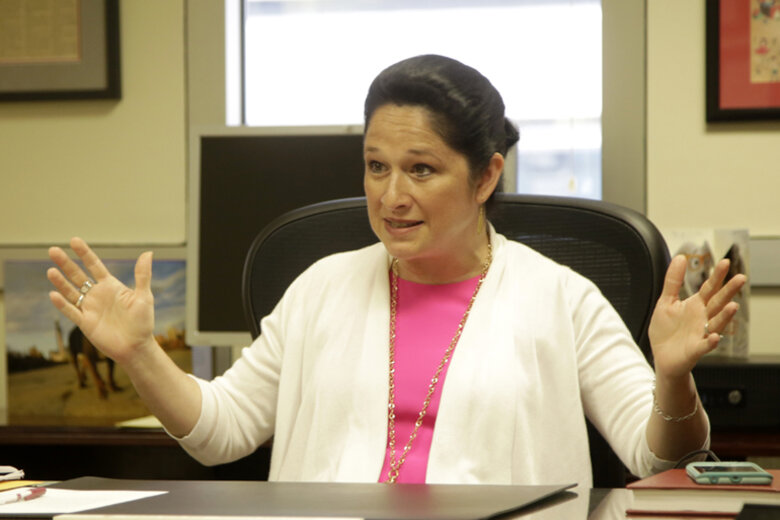 Illinois State Comptroller Susana Mendoza sitting at her desk.