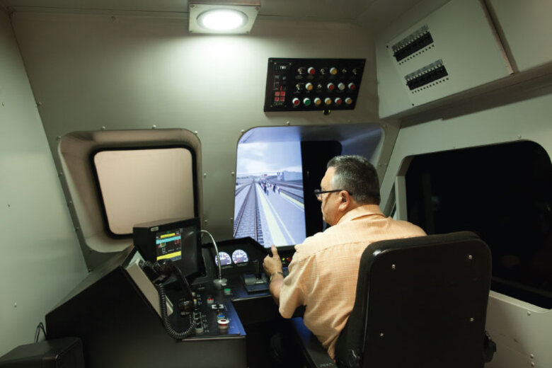 Using a simulator, a trainer demonstrates Metrolink's positive train control system.