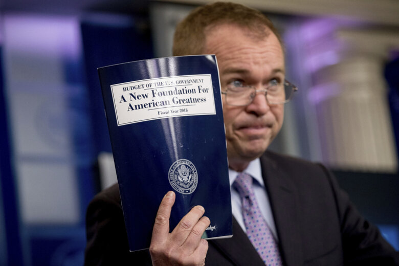 Budget Director Mick Mulvaney holding up President's Trump's proposal.