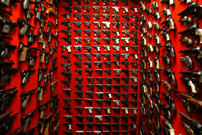 Guns line the walls of the firearms reference collection at the Washington Metropolitan Police Department headquarters.