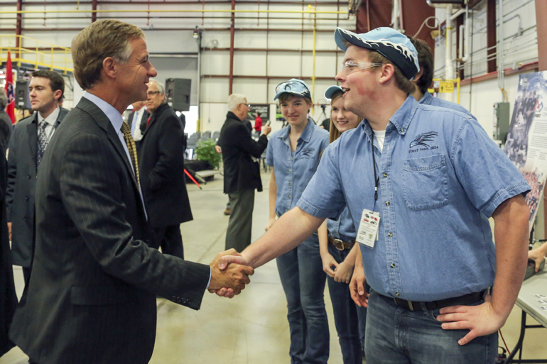 Tennessee Gov. Bill Haslam shaking hands with a factory worker.